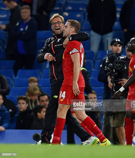 Jurgen Klopp manager of Liverpool with Jordan Henderson at the end the Premier League match between Chelsea and Liverpool at Stamford Bridge on...