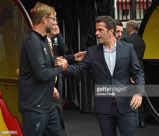 Jurgen Klopp Manager of Liverpool with Marco Silva Manager of watford before the Premier League match between Watford and Liverpool at Vicarage Road...