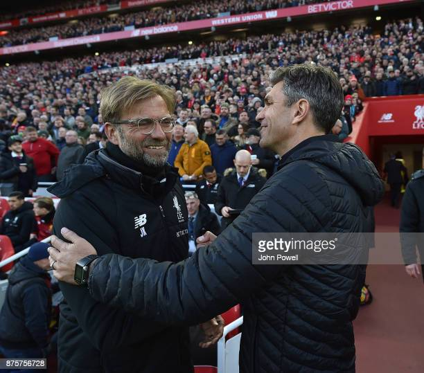 Jurgen Klopp Manager of Liverpool with Mauricio Pellegrino of Southampton during the Premier League match between Liverpool and Southampton at...