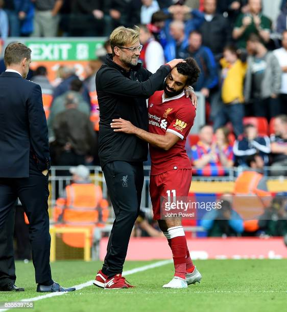 Jurgen Klopp manager of Liverpool with Mohamed Salah during the Premier League match between Liverpool and Crystal Palace at Anfield on August 19...