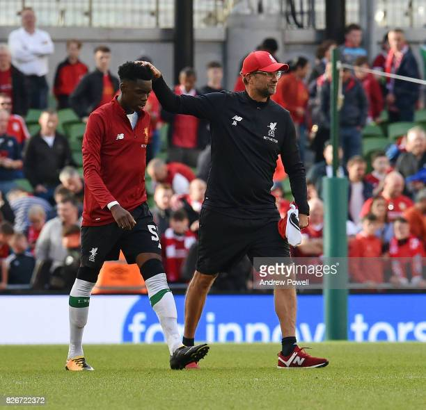 Jurgen Klopp manager of Liverpool with Ovie Ejaria at the end of a pre season friendly match between Liverpool and Athletic Bilbao at Aviva Stadium...