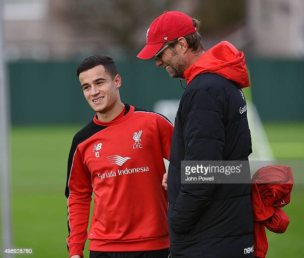 Jurgen Klopp manager of Liverpool with Philippe Coutinho during a training session at Melwood Training Ground on November 27 2015 in Liverpool England