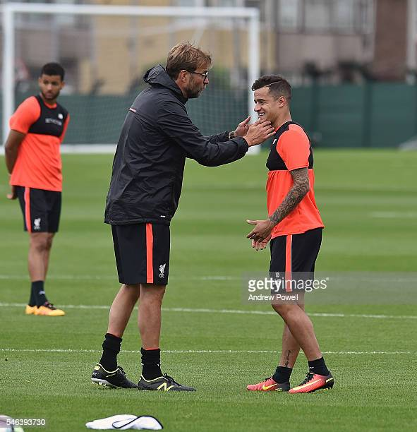 Jurgen Klopp manager of Liverpool with Philippe Coutinho during a training session at Melwood Training Ground on July 12 2016 in Liverpool England