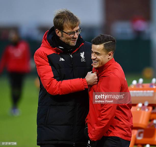 Jurgen Klopp manager of Liverpool with Philippe Coutinho of Liverpool during a training session at Melwood Training Ground on March 1 2016 in...