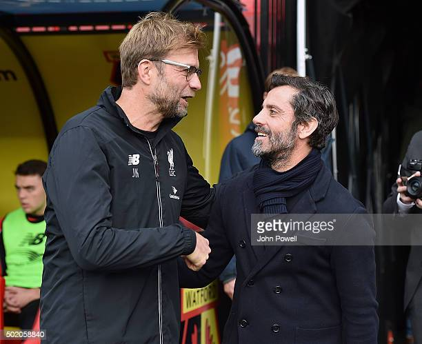Jurgen Klopp manager of Liverpool with Quique Flores manager of Watford at the start of the Barclays Premier League match between Watford and...