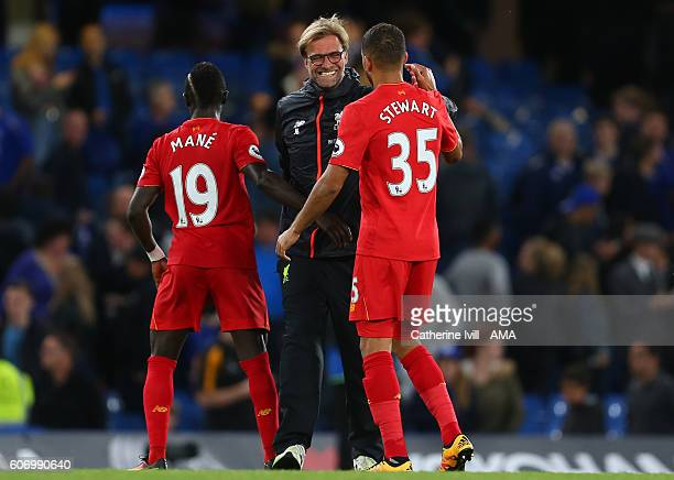 Jurgen Klopp manager of Liverpool with Sadio Mane and Kevin Stewart of Liverpool during the Premier League match between Chelsea and Liverpool at...