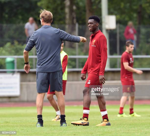 Jurgen Klopp manager talking with Ovie Ejaria of Liverpool during a training session at RottachEgern on July 27 2017 in Munich Germany