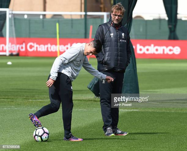 Jurgen Klopp manager with Philippe Coutinho of Liverpool during a training session at Melwood Training Ground on April 26 2017 in Liverpool England