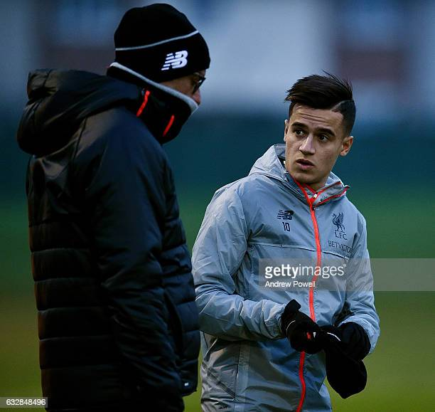 Jurgen Klopp manger of Liverpool with Philippe Coutinho during a training session at Melwood Training Ground on January 27 2017 in Liverpool England