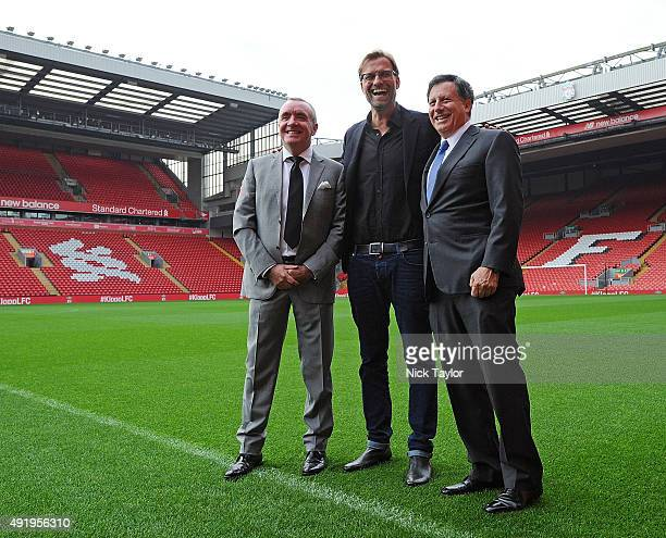 Jurgen Klopp new manager of Liverpool with Tom Werner part owner of Liverpool and Ian Ayre chief executive officer of Liverpool football at Anfield...