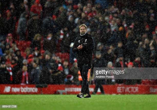 Jurgen Klopp of Liverpool shows his appreciation to the fans at the end of the Premier League match between Liverpool and Everton at Anfield on...