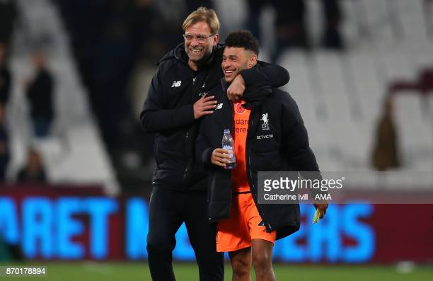 Jurgen Klopp the head coach / manager of Liverpool celebrates with Alex OxladeChamberlain of Liverpool after the Premier League match between West...