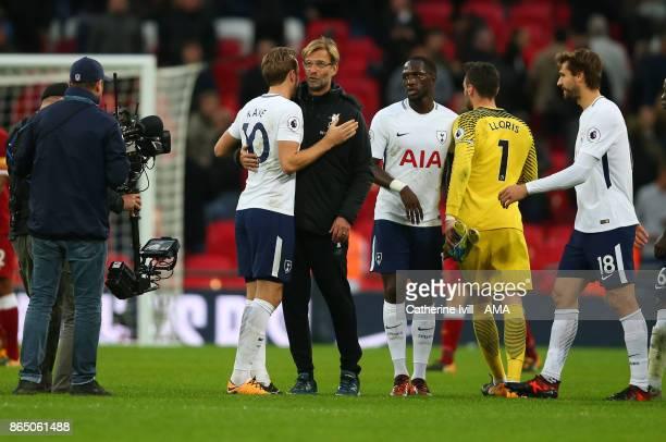 Jurgen Klopp the head coach / manager of Liverpool hugs Harry Kane of Tottenham Hotspur after the Premier League match between Tottenham Hotspur and...