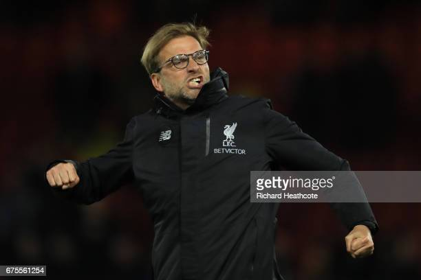 Jurgen Klopp the manager of Liverpool celebrates following his team's 10 victory during the Premier League match between Watford and Liverpool at...