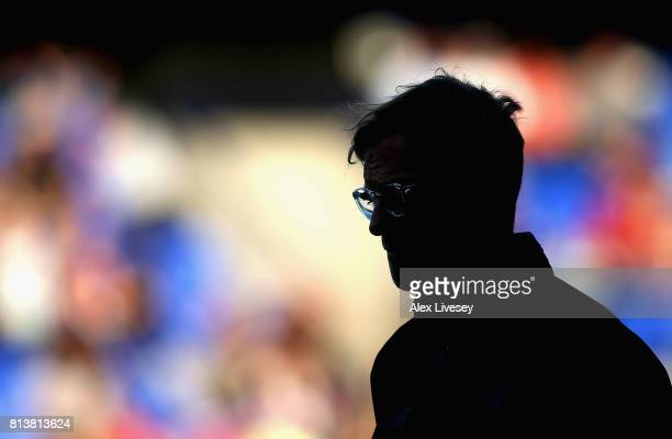 Jurgen Klopp the manager of Liverpool looks on prior to a preseason friendly match between Tranmere Rovers and Liverpool at Prenton Park on July 12...