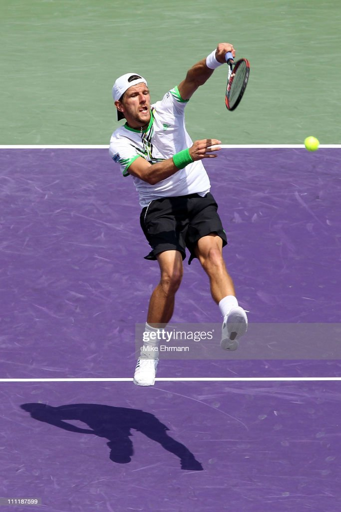 <a gi-track='captionPersonalityLinkClicked' href=/galleries/search?phrase=Jurgen+Melzer&family=editorial&specificpeople=200702 ng-click='$event.stopPropagation()'>Jurgen Melzer</a> of Austria (doubles partner with Philipp Petzschner of Germany) hits a return against Jonathan Erlich of Israel and Andy Ram of Israel during their doubles match at the Sony Ericsson Open at Crandon Park Tennis Center on March 30, 2011 in Key Biscayne, Florida.