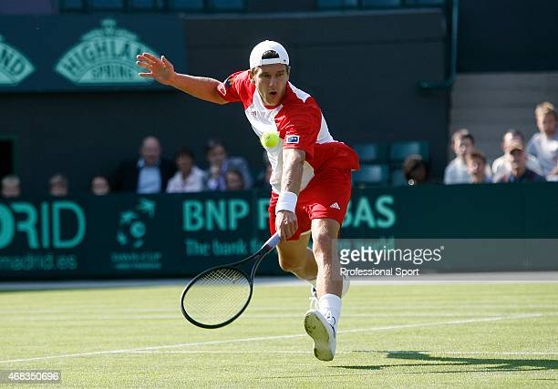 Jurgen Melzer of Austria plays a backhand in his match against Alex Bogdanovic of Great Britain during day one of the Davis Cup World Group Playoff...