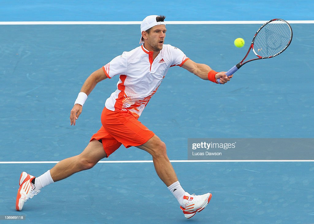 <a gi-track='captionPersonalityLinkClicked' href=/galleries/search?phrase=Jurgen+Melzer&family=editorial&specificpeople=200702 ng-click='$event.stopPropagation()'>Jurgen Melzer</a> of Austria plays a forehand during his match against Gael Monfils of France during day four of the 2012 Kooyong Classic at Kooyong on January 14, 2012 in Melbourne, Australia.