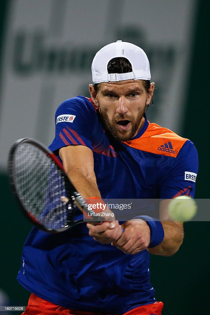 Jurgen Melzer of Austria returns a shot to Kei Nishikori of Japan during day three of the Shanghai Rolex Masters at the Qi Zhong Tennis Center on October 9, 2013 in Shanghai, China.