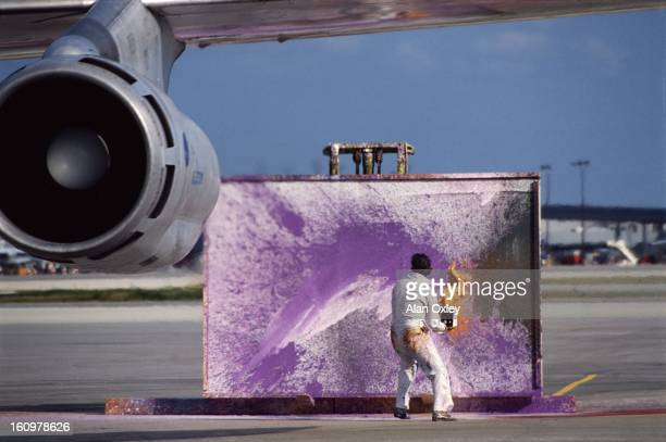 Jurgen Prinz von Anhalt at work on one of his 'Jet Art' paintings at Miami International Airport in May 1984 Anhalt flings paint into the jet stream...