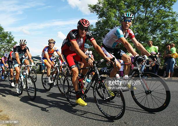 Jurgen Van de Walle of Belgium and Omega PharmaLotto rides with Marcus Burghardt of Germany and the BMC Racing Team during stage nine of the 2011...