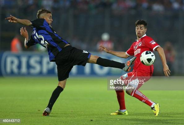 Juri Cisotti of Latina competes for the ball with Stefano Sabelli of Bari during the Serie B playoff match between US Latina and AS Bari at Stadio...