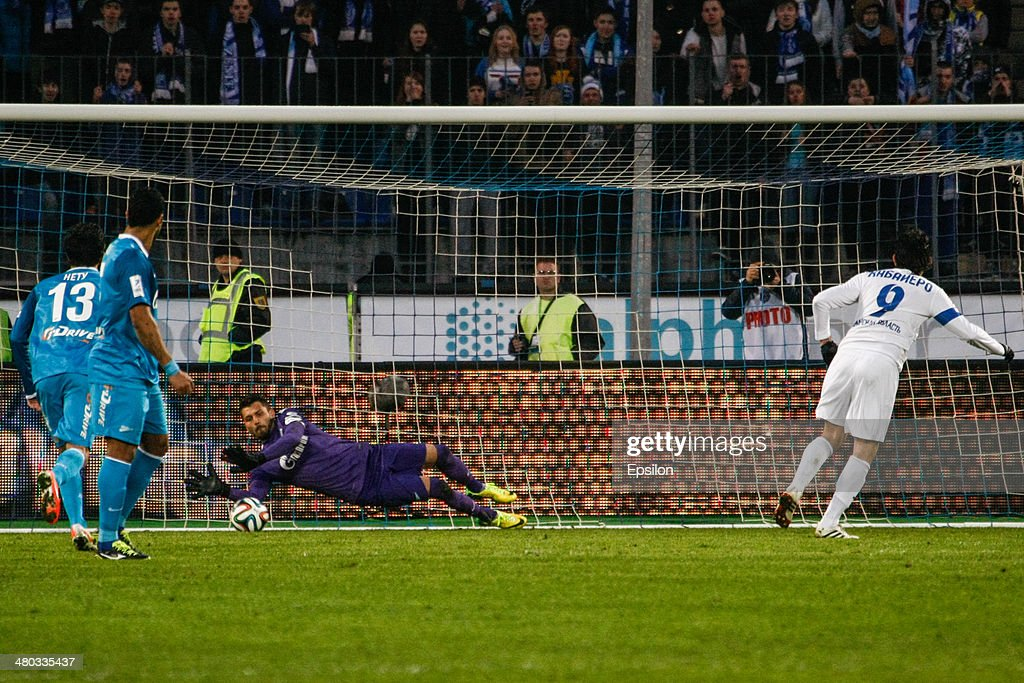 Juri Lodigin of FC Zenit St. Petersburg (C) saves a penalty shot by Luis Caballero of PFC Krylia Sovetov Samara (R) during the Russian Football League Championship match between FC Zenit St. Petersburg and FC Krylia Sovetov Samara at the Petrovsky stadium on March 24, 2014 in St. Petersburg, Russia.