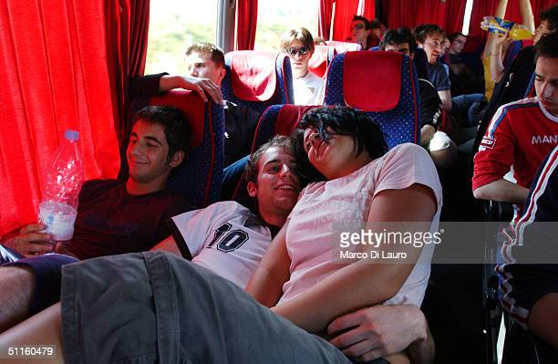 Enrico Morsiani and Sonia Rebecchi Italian students from the Primo Levi Technical Institute of Vignola in the Modena Province snuggle on a bus during...
