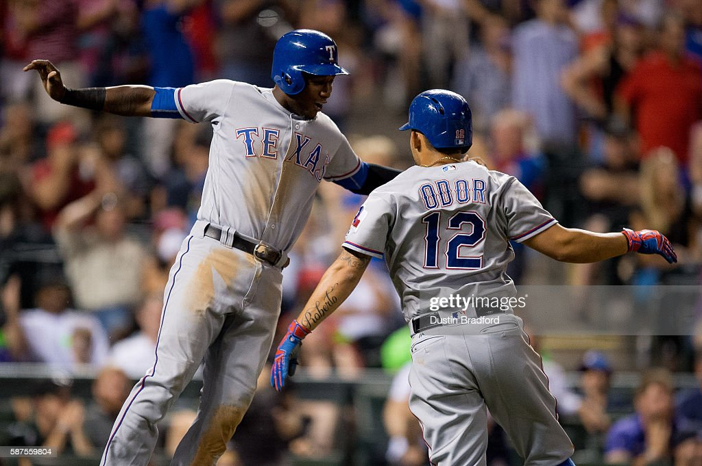 Jurickson Profar #19 and Rougned Odor #12 of the Texas Rangers celebrate as they score two runs to tie a game against the Colorado Rockies in the ninth inning of a game at Coors Field on August 8, 2016 in Denver, Colorado.
