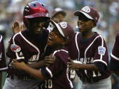 Jurickson Profar of Curacao is congratulated by Willie Rifaela and the rest of his teammates after he hit a tworun home run in first inning against...