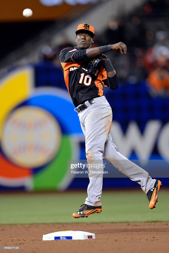 <a gi-track='captionPersonalityLinkClicked' href=/galleries/search?phrase=Jurickson+Profar&family=editorial&specificpeople=2253684 ng-click='$event.stopPropagation()'>Jurickson Profar</a> #10 of the Netherlands throws the ball to first but scores an error against the Dominican Republic during the semifinal of the World Baseball Classic at AT&T Park on March 18, 2013 in San Francisco, California.