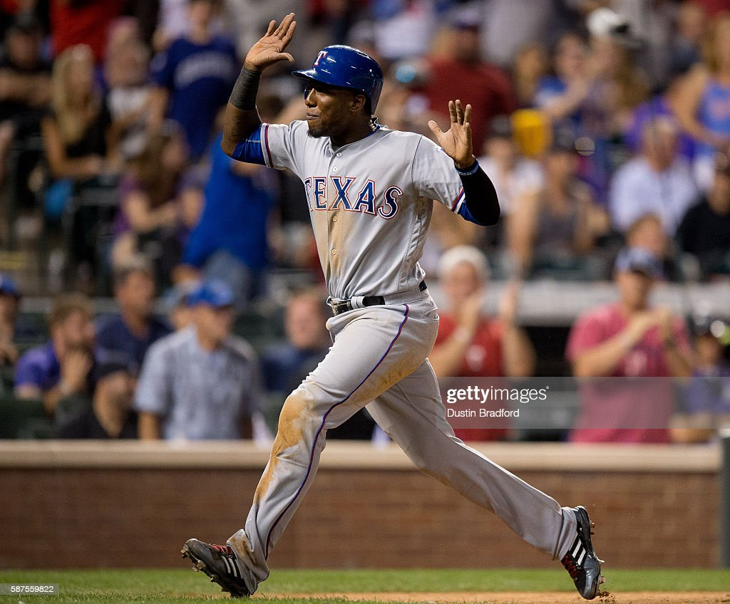 Jurickson Profar #19 of the Texas Rangers begins to celebrate as he scores the tying run in the ninth inning of a game against the Colorado Rockies at Coors Field on August 8, 2016 in Denver, Colorado.