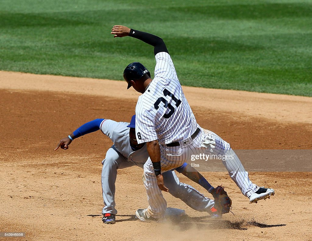 <a gi-track='captionPersonalityLinkClicked' href=/galleries/search?phrase=Jurickson+Profar&family=editorial&specificpeople=2253684 ng-click='$event.stopPropagation()'>Jurickson Profar</a> #19 of the Texas Rangers catches <a gi-track='captionPersonalityLinkClicked' href=/galleries/search?phrase=Aaron+Hicks&family=editorial&specificpeople=5471630 ng-click='$event.stopPropagation()'>Aaron Hicks</a> #31 of the New York Yankees stealing in the fifth inning at Yankee Stadium on June 30, 2016 in the Bronx borough of New York City.