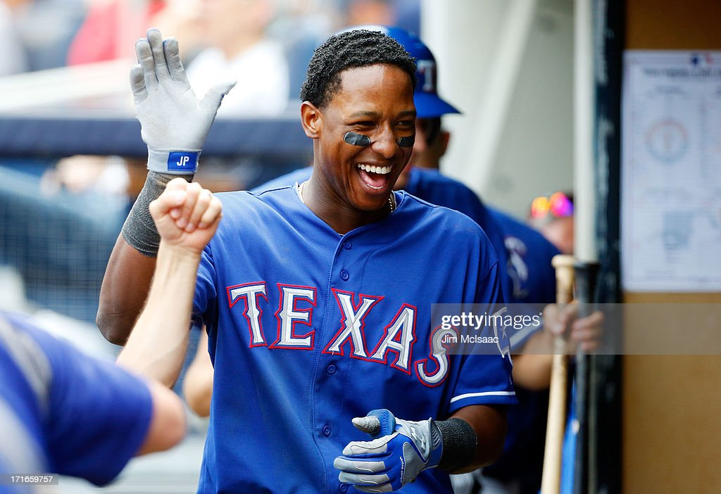 <a gi-track='captionPersonalityLinkClicked' href=/galleries/search?phrase=Jurickson+Profar&family=editorial&specificpeople=2253684 ng-click='$event.stopPropagation()'>Jurickson Profar</a> #13 of the Texas Rangers celebrates his fifth inning home run against the New York Yankees at Yankee Stadium on June 27, 2013 in the Bronx borough of New York City.