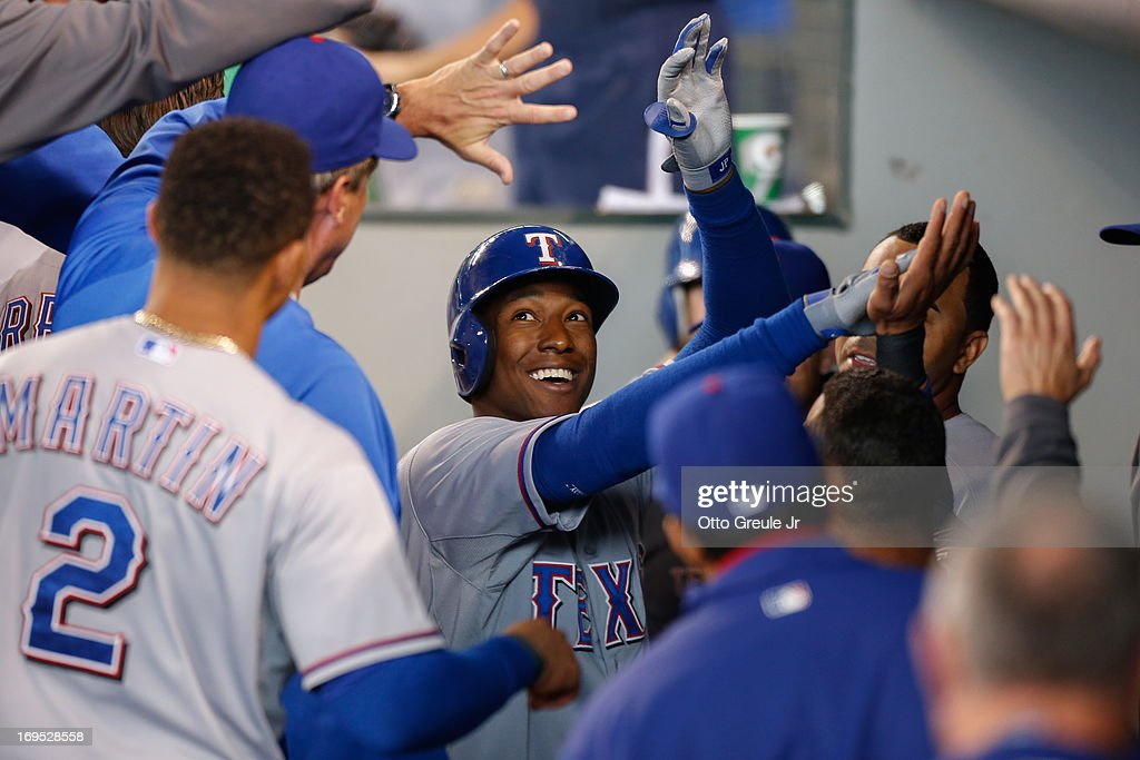 Jurickson Profar #13 of the Texas Rangers is congratulated by teammates after hitting a home run in the first inning against the Seattle Mariners at Safeco Field on May 26, 2013 in Seattle, Washington.