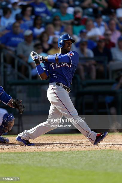 Jurickson Profar of the Texas Rangers makes some contact at the plate during the spring training game against the Kansas City Royals at Surprise...