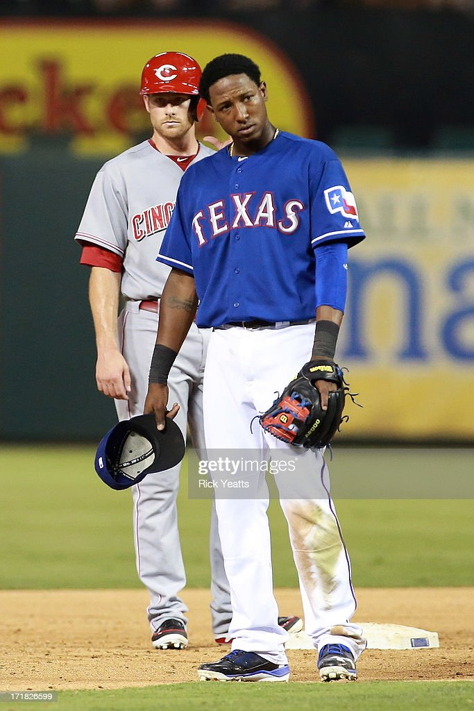 <a gi-track='captionPersonalityLinkClicked' href=/galleries/search?phrase=Jurickson+Profar&family=editorial&specificpeople=2253684 ng-click='$event.stopPropagation()'>Jurickson Profar</a> #13 of the Texas Rangers reacts to a wild pitch by teammate Martin Perez #33 allowing <a gi-track='captionPersonalityLinkClicked' href=/galleries/search?phrase=Zack+Cozart&family=editorial&specificpeople=6889199 ng-click='$event.stopPropagation()'>Zack Cozart</a> #2 of the Cincinnati Reds to advance to second base in the sixth inning at Rangers Ballpark in Arlington on June 28, 2013 in Arlington, Texas.