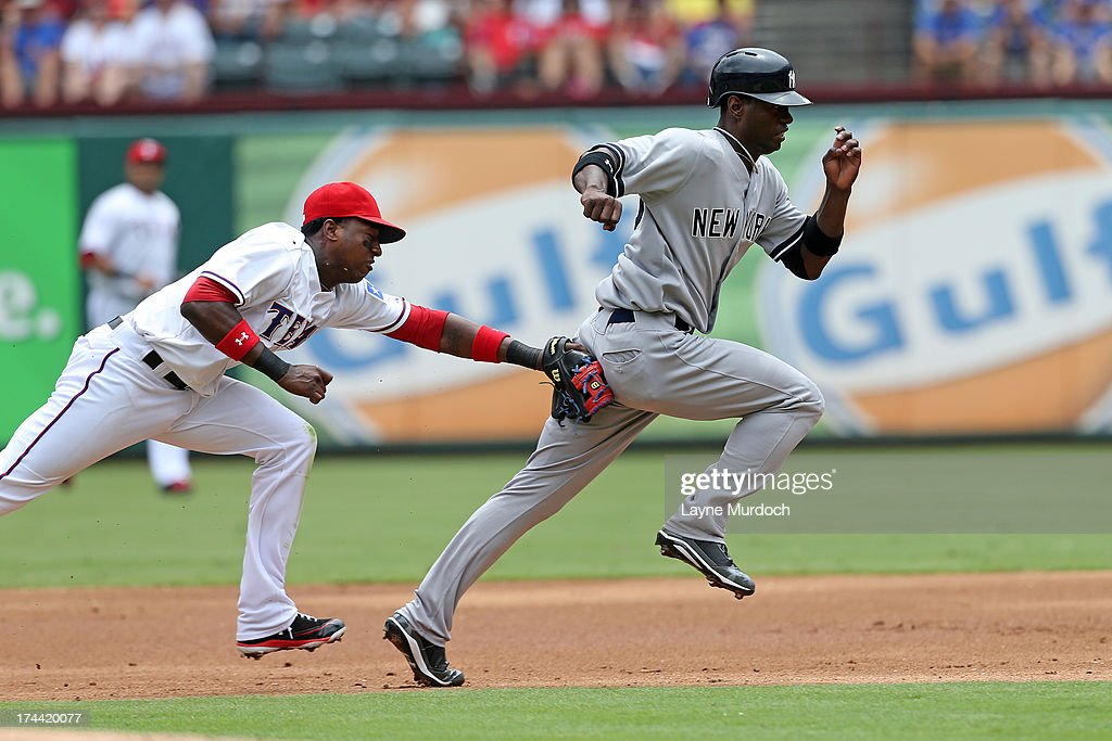 <a gi-track='captionPersonalityLinkClicked' href=/galleries/search?phrase=Jurickson+Profar&family=editorial&specificpeople=2253684 ng-click='$event.stopPropagation()'>Jurickson Profar</a> #13 of the Texas Rangers runs down Melky Mesa #60 of the New York Yankees on July 25, 2013 at the Rangers Ballpark in Arlington in Arlington, Texas.