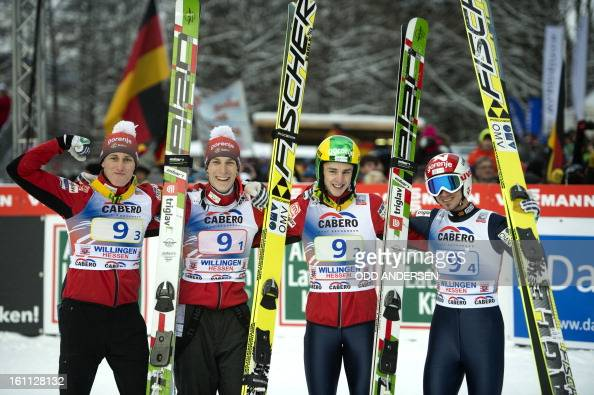 Jurij Tepes Jaka Hvala Peter Prevc and Robert Kranjec of Slovenia celebrate winning the FIS Ski Jumping World Cup team competition on the...