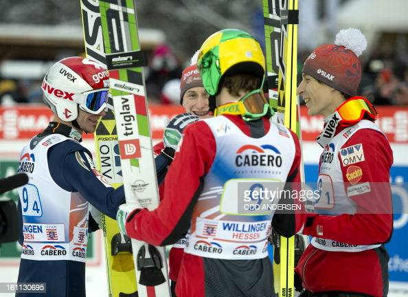 Jurij Tepes Jaka Hvala Peter Prevc and Robert Kranjec of Slovenia talk during the FIS Ski Jumping World Cup team competition on the...