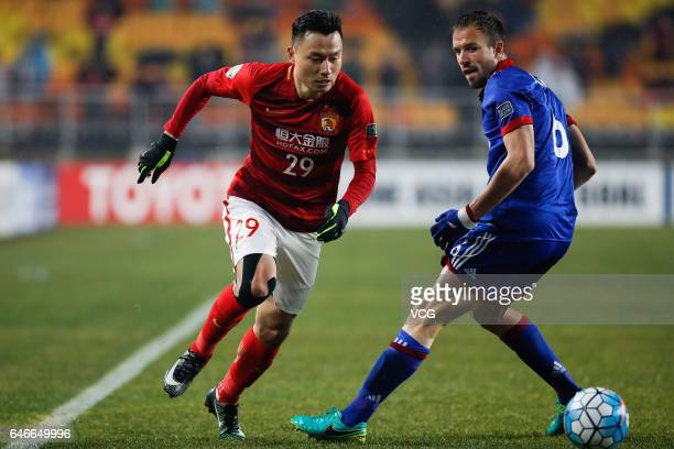Jurman of Suwon Samsung Bluewings and Gao Lin of Guangzhou Evergrande compete for the ball during the AFC Champions League 2017 Group G match between...