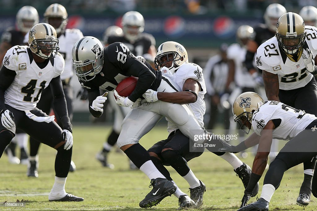 <a gi-track='captionPersonalityLinkClicked' href=/galleries/search?phrase=Juron+Criner&family=editorial&specificpeople=6535045 ng-click='$event.stopPropagation()'>Juron Criner</a> #84 of the Oakland Raiders in action against the New Orleans Saints at O.co Coliseum on November 18, 2012 in Oakland, California.