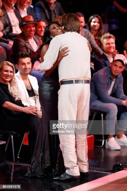Juror Motsi Mabuse hugs Joerg Draeger after his performance on stage during the 1st show of the tenth season of the television competition 'Let's...