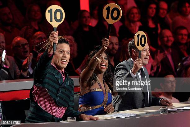 Jurors Jorge Gonzalez Motsi Mabuse and Joachim Llambi show the 10pointssign during the 7th show of the television competition 'Let's Dance' at...