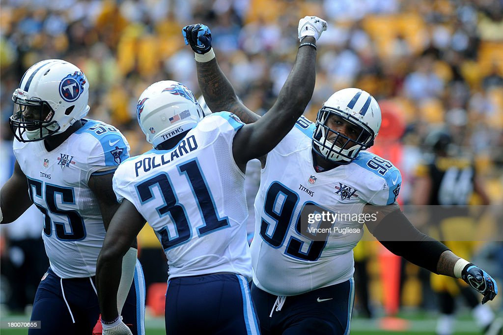 Jurrell Casey # 99 of the Tennessee Titans celebrates with <a gi-track='captionPersonalityLinkClicked' href=/galleries/search?phrase=Bernard+Pollard&family=editorial&specificpeople=630572 ng-click='$event.stopPropagation()'>Bernard Pollard</a> #31 of the Tennessee Titans after a sack late in the fourth quarter against the Pittsburgh Steelers at Heinz Field on September 8, 2013 in Pittsburgh, Pennsylvania.