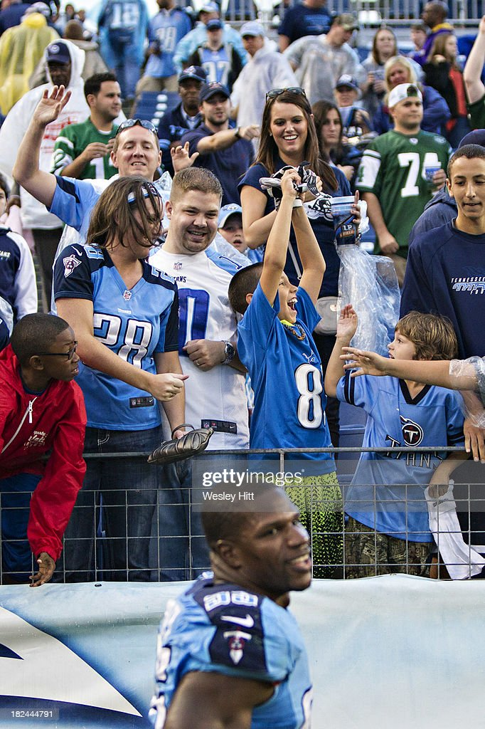 <a gi-track='captionPersonalityLinkClicked' href=/galleries/search?phrase=Jurrell+Casey&family=editorial&specificpeople=5551373 ng-click='$event.stopPropagation()'>Jurrell Casey</a> #99 of the Tennessee Titans throws his glove to a excited fan after a game against the New York Jets at LP Field on September 29, 2013 in Nashville, Tennessee. The Titans defeated the Jets 38-13.