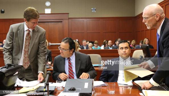 Jury consultant Robert Hirschhorn confers with defense attorney Mark O'Mara as cocounsel Don West talks to defendant George Zimmerman on the second...