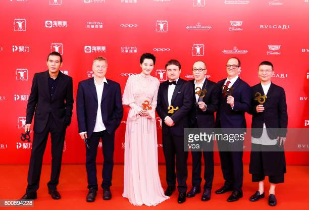 Jury Japanese director Sabu USA/Macedonian director Milcho Manchevski Chinese actress Xu Qing Romanian director Cristian Mungiu Chinese director...