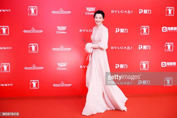 Jury member Chinese actress Xu Qing poses on the red carpet of Golden Goblet Awards and Closing Ceremony of 20th Shanghai International Film Festival...