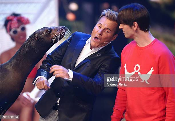 Jury member Dieter Bohlen is kissed by a sea lion while trainer Erwin Frankello looks on during the 'Das Supertalent' final show on December 12 2015...